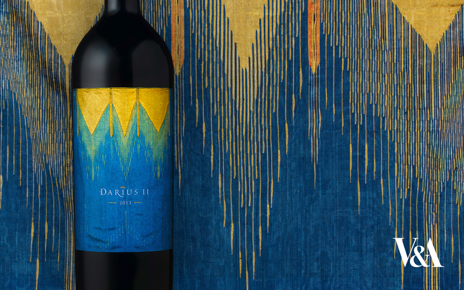 Blue and yellow silk tapestry with matching wine bottle in front