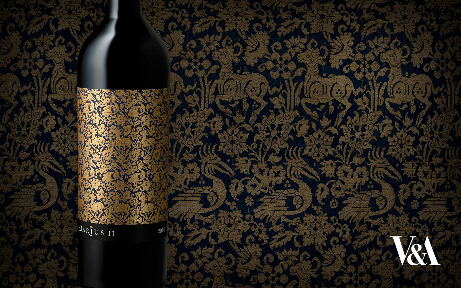 Gold and blue tapestry with matching wine bottle in front